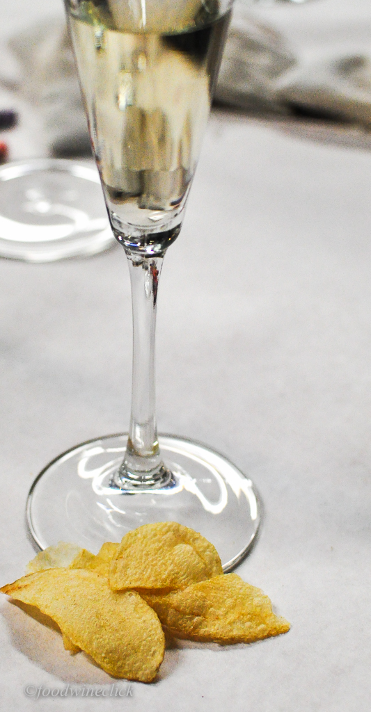 (Inexpensive)Sparkling wine and potato chips!  Surprise!