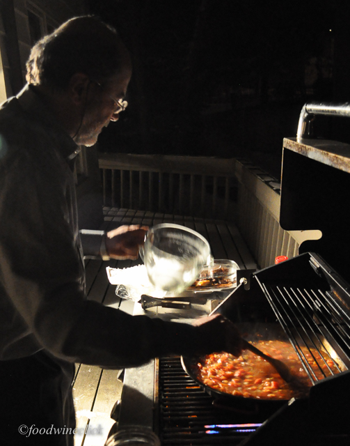 Bruce cooks the paella on the grill as it offers a large cooking area for the pan.