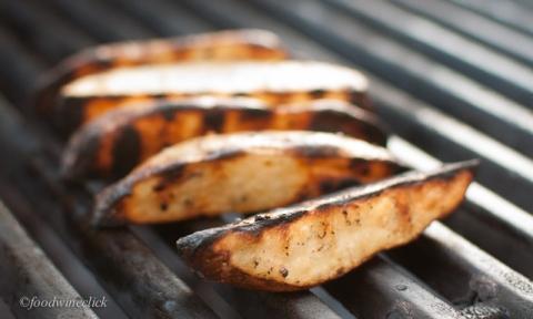Sliced potatoes with bit of oil, salt & pepper