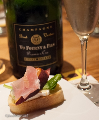 Premier Cru Champagne with a wonderful bite of prosciutto, arugula, peaches & brie