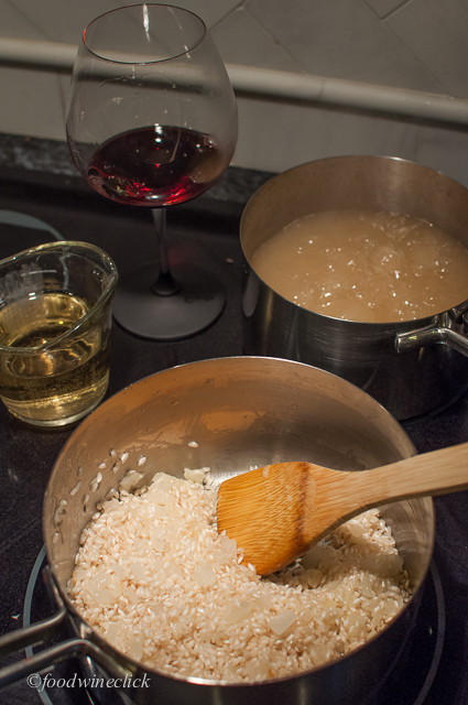 Feed the risotto liquid a little at a time, then take a sip of wine.