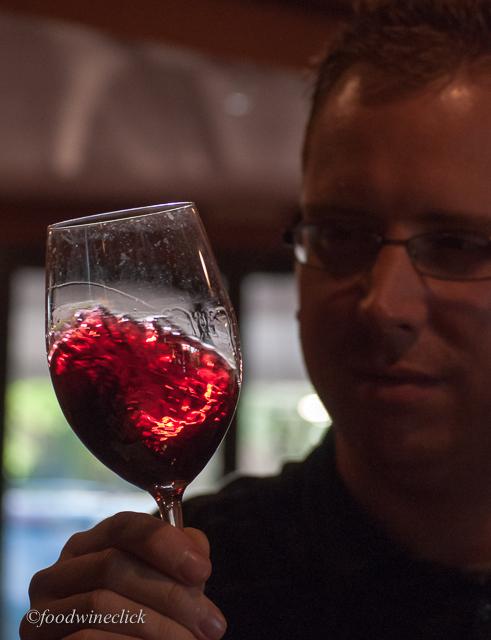 Nicholas swirling a glass of Cabernet Sauvignon
