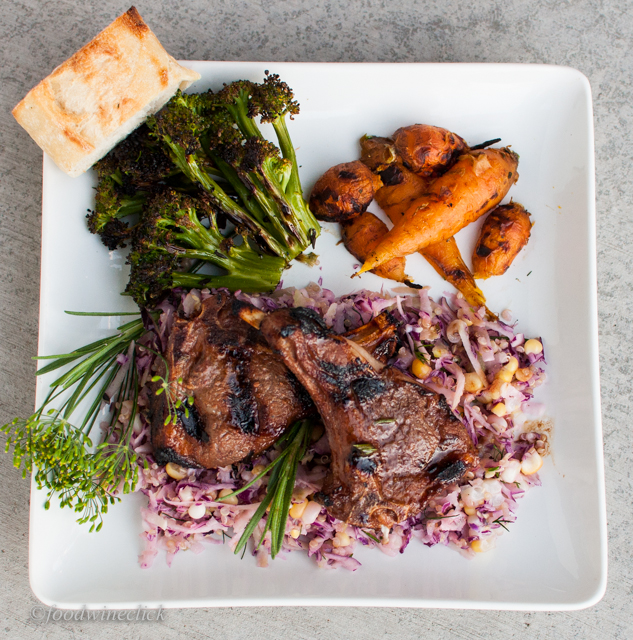 Grilled Lamb Chops on a bed of slaw with roasted brocolli and carrots