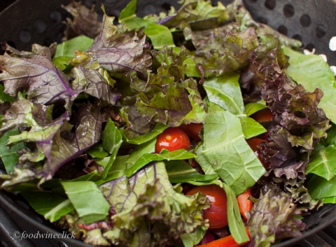 salad ingredients in a grill basket