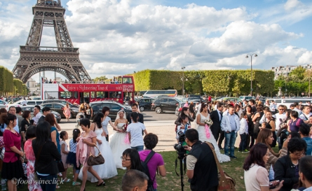 brides at the eiffel tower
