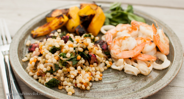 Cous-cous with roasted radishes and radish greens surrounded by shrimp, calamari, and roasted mango
