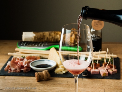 Transport yourself to Italy by enjoying a full assortment of antipasti and wine from Emilia-Romagna