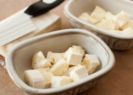 Cut the cheese into cubes to break up the surface rind