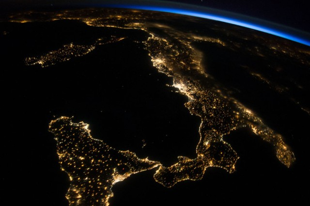 Italy at night as seen by Astronaut Reid Wiseman. Notice the black hole with red center; that's Mt. Etna with lava core! (photo courtesy of NASA)