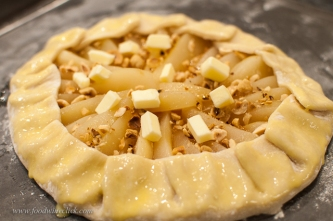 Wrap up the galette crust, add hazelnuts, a bit of butter and egg wash