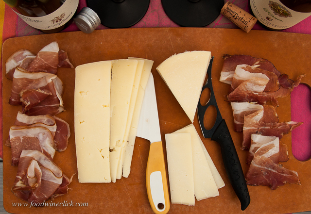 Our Apertivo board features two different Speck hams with Trugole and Provolone Valpadana cheeses.
