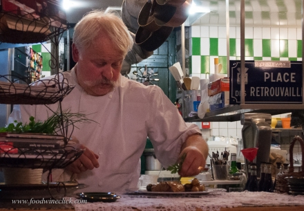 Here you want the focus on the chef's face, don't take a chance with automatic focus settings.