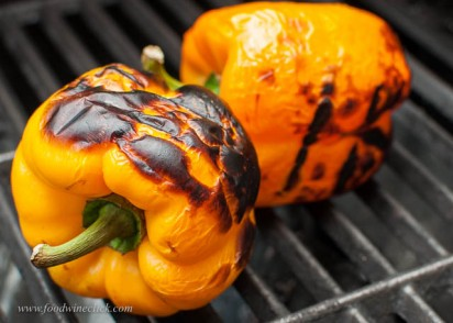 Blacken the peppers over a hot flame or out at your grill