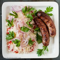 Drizzle with equal parts apple cider vinegar and extra virgin olive oil, add your brats and go for it!
