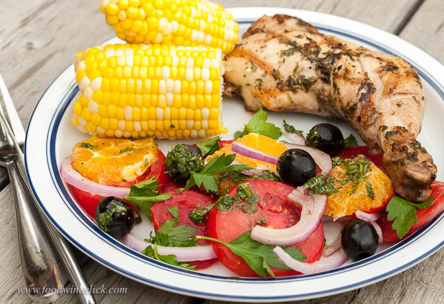 Southern France with a touch of Minnesota. Grilled chicken with bistro salad of tomatoes & oranges. Sweet corn on the side, you know, for that exotic foreign touch.