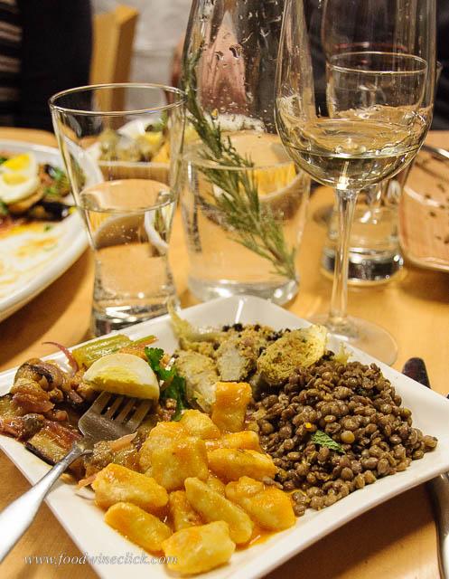 Eggplant caponata, ricotta gnocchi, lentils, and stuffed artichokes