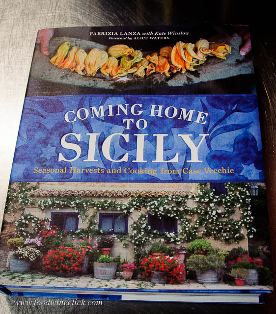 "Tonight, we're cooking from ""Coming Home to Sicily"" by Fabrizia Lanza. The Casa Vecchie cooking school is part of the Regaleali Estate and Winery, where our evening's wine is from."