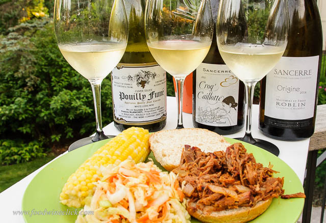 Pulled pork sandwiches just prior to the application of the coleslaw. Spicy vinegar sauce and slaw were perfect with acidic French Sauvignon Blanc. Who knew?
