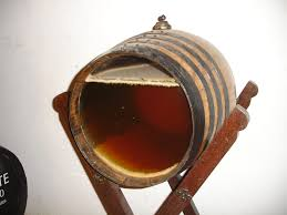 1 barrel from a solera system showing the wine, airspace above and flor (yeast cap on the surface). (photo courtesy of wikipedia.org)