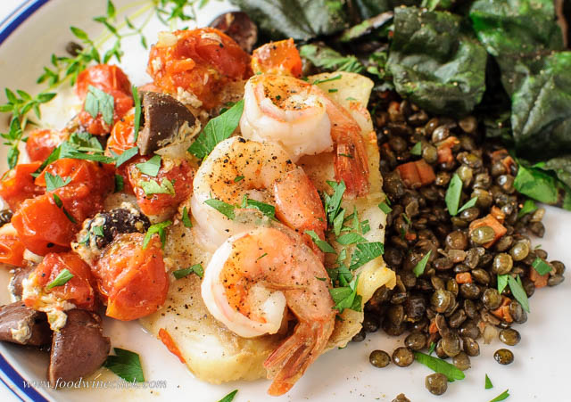 Cod packet with bonus shrimp on a lentil bed makes it French!