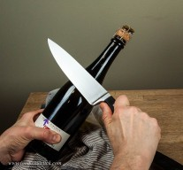 Practice by slowly sliding the knife along the bottle seam. One, two, on three you go!