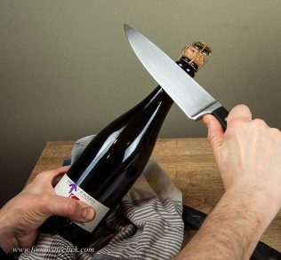 Note that you are going to break the very top of the glass bottle off, many people think you just hit the cork, not so!