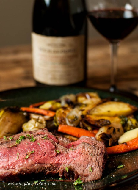 Flank steak, roasted root vegetables and a glass of red wine