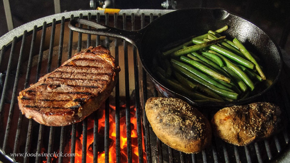 Primo grill with ribeye steak