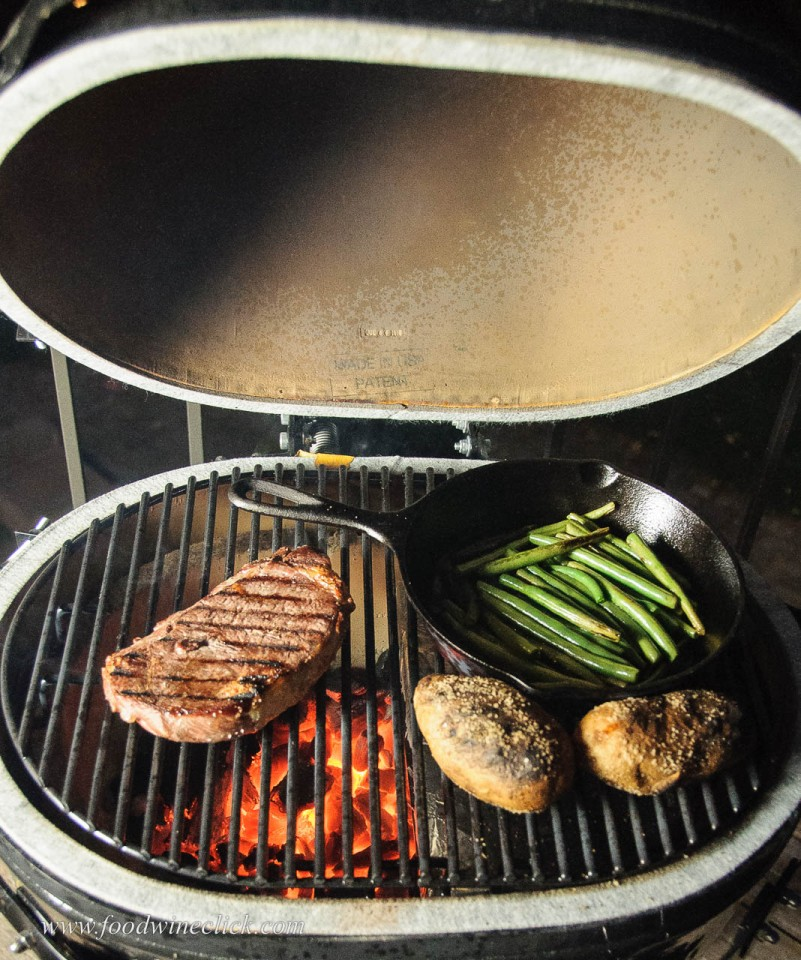 Primo grill with ribeye steak, potatoes and green beans