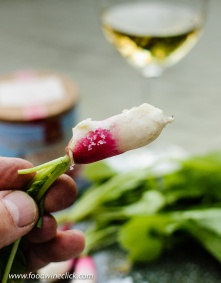 You simply swipe the radish in a bit of butter, then dip in the salt. Delicious! Go ahead and eat the leaves, too.
