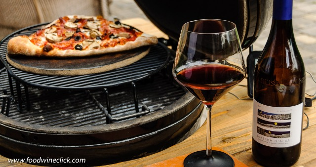 Pizza cooked on a Primo ceramic grill with Trediberri Barbera d'Alba