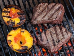 Peaches and tenderloin steaks on the Primo ceramic grill