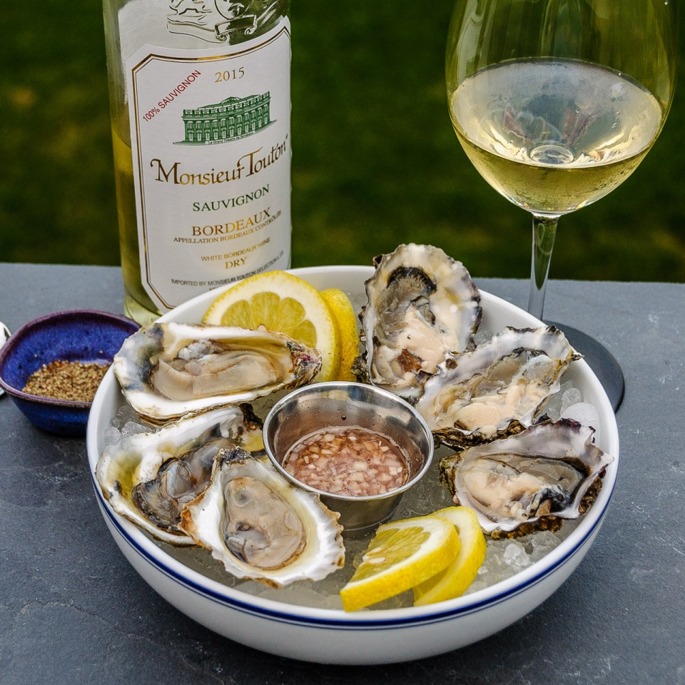 Raw oyster plate with Bordeaux Blanc