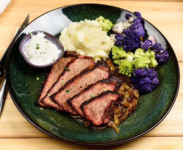 Grill braised brisket with onions and horseradish sauce