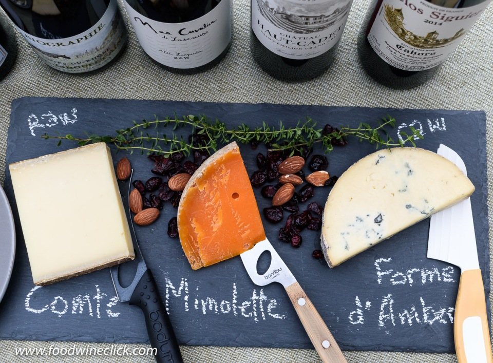 A cheese board includes blue cheese