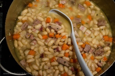 cooking beans, ham hock and pork belly for cassoulet