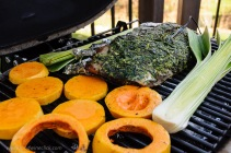 grilled vegetables and rack of lamb on a primo ceramic grill