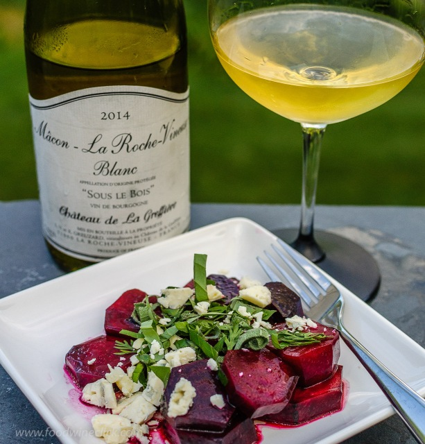A white Burgundy wine served alongside a beet salad