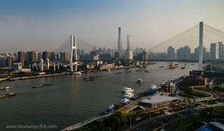 Shanghai boasts an impressive skyline during the day...