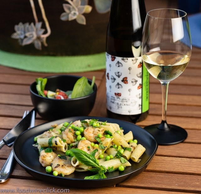 Fresh peas top a Shrimp, penne & basil dish paired with Alsace Pinot Blanc at www.foodwineclick.com
