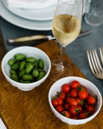 Tiny melon cucumbers, cherry tomatoes and a bit of Champagne
