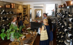 Curated wines and a special selection of cooking utensils inside. Cooking class is upstairs
