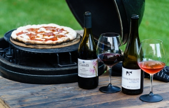 500°F+ is no problem on the Primo. Just don't leave the wine there very long!