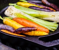 Leeks and carrots roast in cast iron