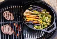 Consolidate the veggies on the indirect side when it's time to cook the steaks