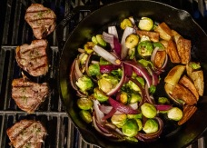Grilled dinner, as requested. Lamb chops, potato wedges, brussels sprouts and red onions.