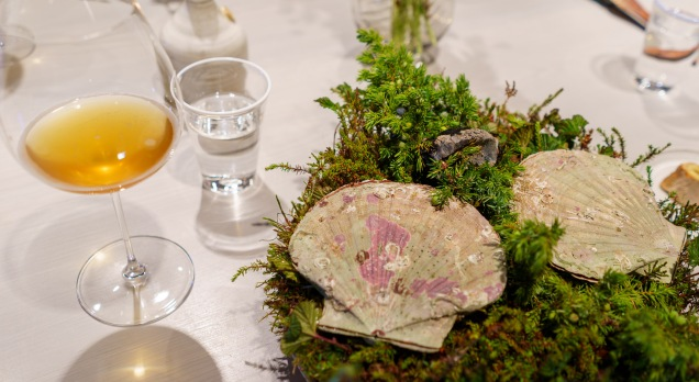 A signature dish, scallop cooked over burning juniper branches