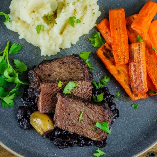 The unusually dark material under the roast was carmelized onions then reduced in red wine.