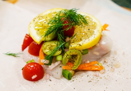 Fresh vegetables, halibut, lemon and herbs, and a bit of extra virgin olive oil. That's it!