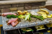 The broiler under the granite serves to both melt the cheese and heat the veggies